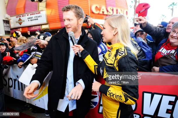 Miss Sprint Cup Brooke Werner interviews Sprint Cup Series driver Dale Earnhardt Jr at a fanfest hosted by Las Vegas Motor Speedway on the Third...