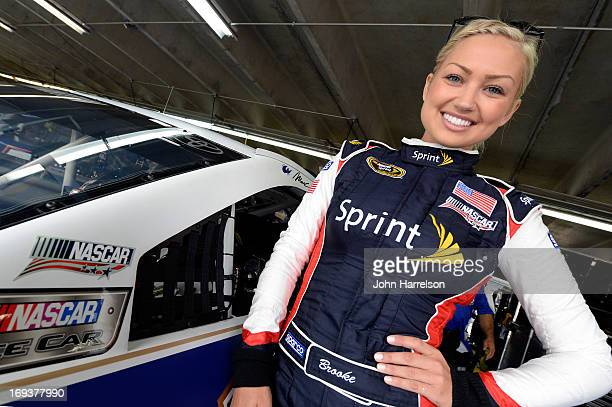 Miss Sprint Cup Brooke Werner stand in the garage during practice for the NASCAR Sprint Cup Series CocaCola 600 at Charlotte Motor Speedway on May 23...