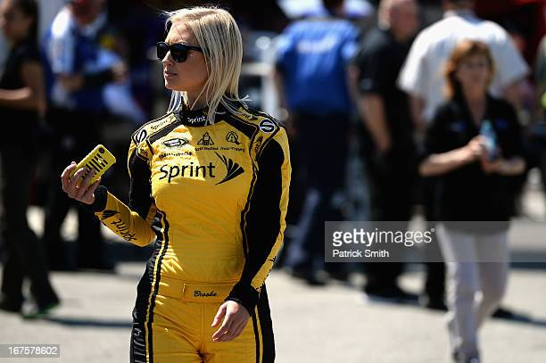 Miss Sprint Cup Brooke Werner walks through the garage during practice for the NASCAR Sprint Cup Series Toyota Owners 400 at Richmond International...