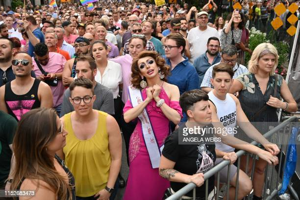 Miss Stonewall 2019 Cissy Walken gathers with others on Christopher Street outside the Stonewall Inn for a rally to mark the 50th anniversary of the...