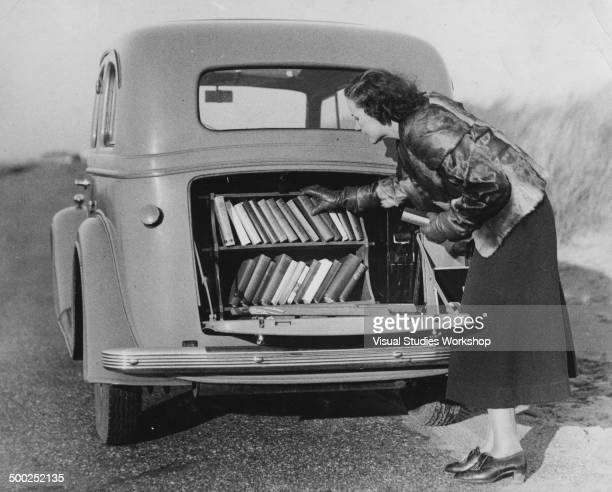 Miss Sutton a Kentish resident has fit a bookcase in the back of her car so that she will always have a wide variety of reading material when pulling...