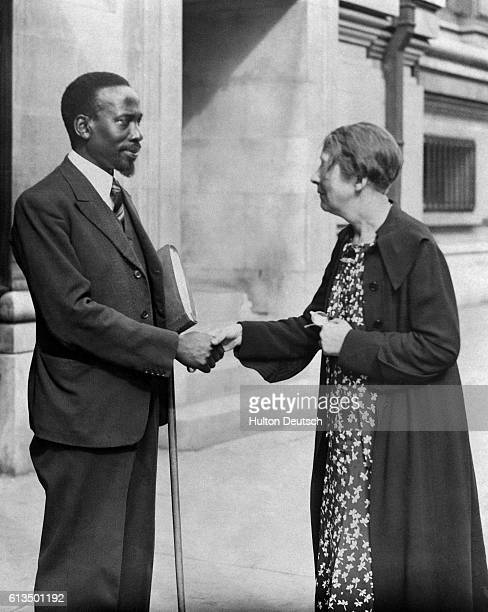 Miss Sylvia Pankhurst daughter of the famous Suffragette shakes hands with Jomo Kenyatta at the 'Abyssinia and Justice' conference September 9 1937
