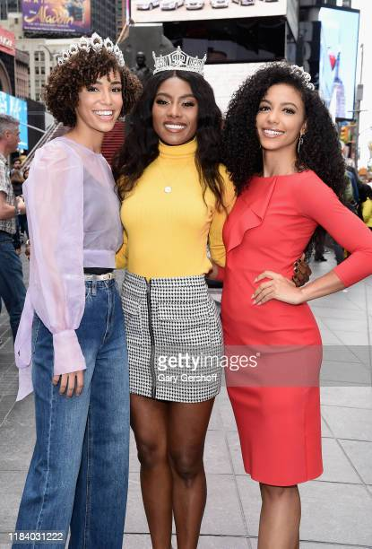 Miss Teen USA Kaliegh Garris Miss America Nia Franklin and Miss USA Cheslie Kryst pose in Times Square after their visit to Extra at the R Lounge at...