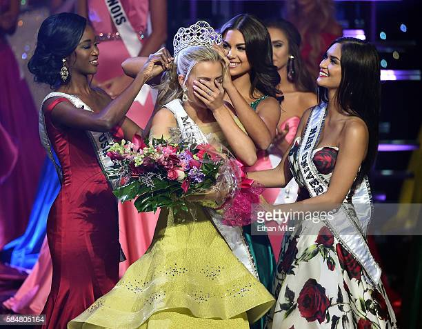 Miss Texas Teen USA 2016 Karlie Hay reacts as Miss USA 2016 Deshauna Barber Miss Teen USA 2015 Katherine Haik and Miss Universe 2015 Pia Alonzo...