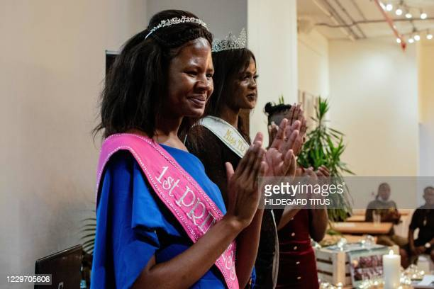Miss Trans Ambassador 2019 Penelope Delaripoirto along with first runner up Brihanna Vries pose during a ceremony to support the transgender...