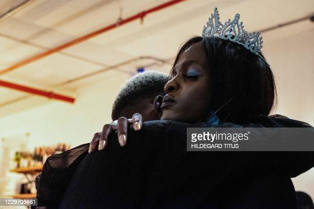 Miss Trans Ambassador 2019 Penelope Delaripoirto hugs a person during a ceremony to support the transgender community and raise awareness on the...