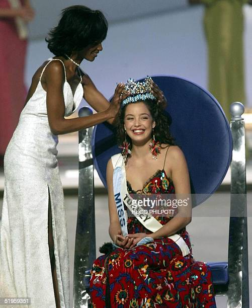 Miss Turkey Azra Akin is crowned 2002 Miss World by previous Miss World Nigeria's Agbani Darego 07 December 2002 at the Alexandra Palace in London...