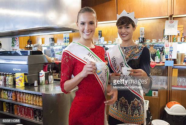 Miss Tv Sorrisi e Canzoni 2015 and Miss Italia 2015 Ginevra Bertolani and Alice Sabatini posing holding a cup of coffee for a photo shooting at...