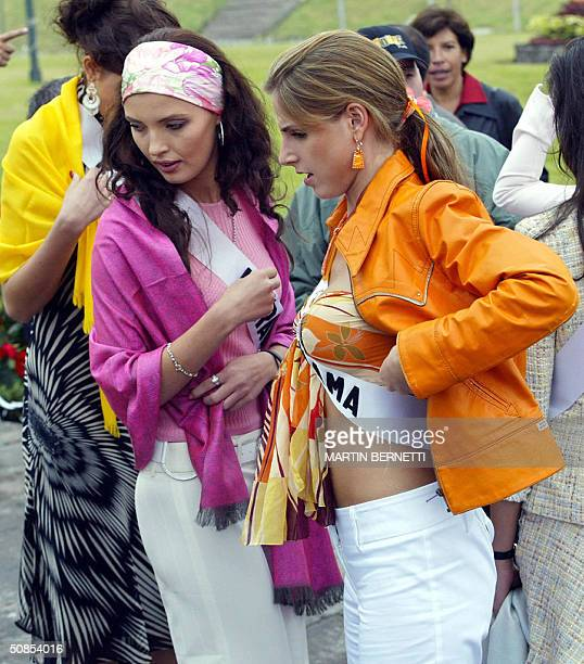 Miss Ukraine Oleksandra Nikolayenko and Miss Panama Jessica Rodriguez chat while they visit the Middle of the World monument 18 May 2004 in Quito...