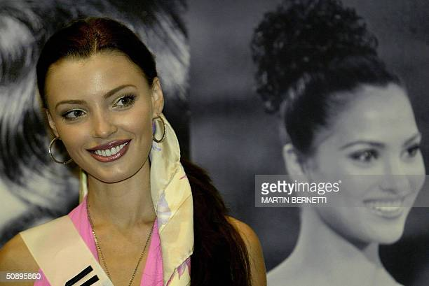 Miss Ukraine Oleksandra Nikolayenko poses to photographers during an interview in Quito Ecuador 25 May 2004 The Miss Universe 2004 contest will take...