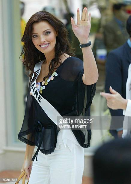 Miss Ukraine Oleksandra Nikolayenko waves at photographers 20 May 2004 in Quito The Miss Universe 2004 contest will take place in Ecuador on 1 June...