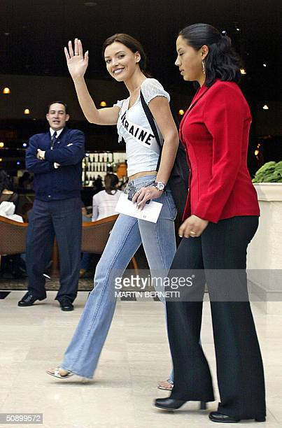 Miss Ukraine Oleksandra Nikolayenko waves to the press while leaving the hotel in Quito 26 May 2004 The Miss Universe 2004 contest will take place on...