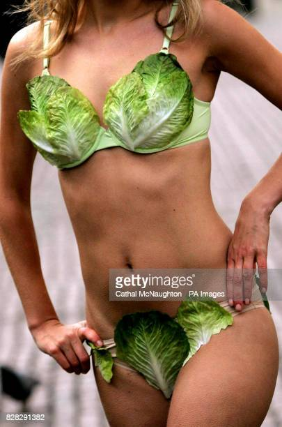Miss United Kingdom Brooke Johnston wearing a lettuce leaf bikini to unveil PETA's new 'Turn Over a New LeafTry Vegetarian' campaign at Covent Garden...