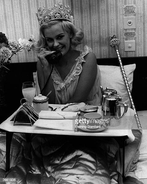 Miss United Kingdom, Lesley Langley, enjoys breakfast in bed the day after winning the 1965 Miss World contest in London, 20th November 1965.