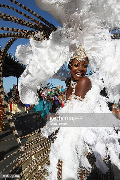 Miss Universe 1998 Wendy Fitzwilliam from the band 'Dominion of the Sun' by Harts performs in the Queen's Park Savannah during the Parade of Bands as...