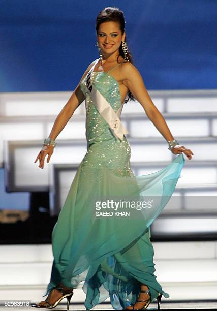 Miss Universe 2005 contestant Amrita Thapar of India perform during first round of judging in the swimwear and evening gown competition in Bangkok 26...