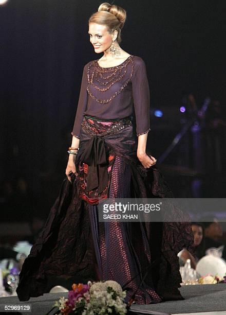 Miss Universe 2005 contestant Jelena Mandic of Serbia Montenegro displays Thai Silk outfits at a fashion show in Bangkok 23 May 2005 Jennifer Hawkins...