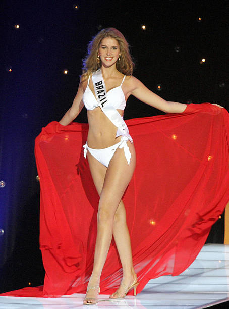 Miss Universe 2005 contestant Miss Brazil Carina Beduschi performs during the first round of judging in the swimwear and evening gown competition in...