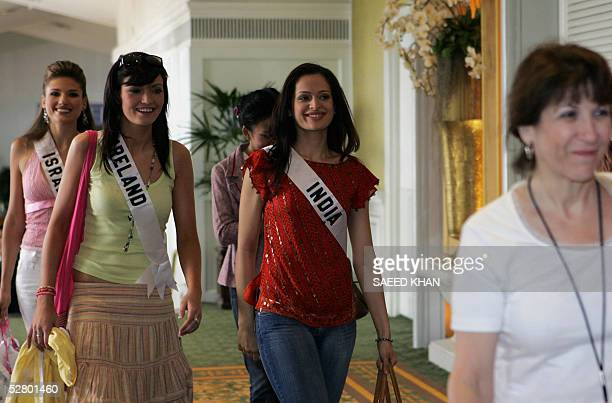 Miss Universe 2005 contestants Miss Israel Elena Ralph Miss Ireland Mary Gormley and Miss India Amrita Thapar arrive at Thai fruits introduction...