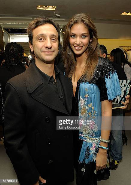 Miss Universe 2008 Dayana Mendoza and guest attend the Michael Roberts Book Party hosted by Eva Roberto Cavalli during MercedesBenz Fashion Week at...