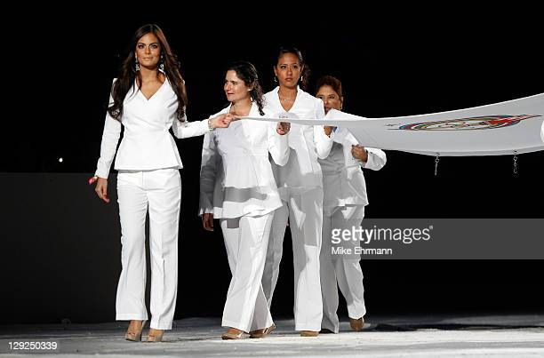 Miss Universe 2010 Ximena Navarrete and LPGA golfer Lorena Ochoa carry the PASO flag during the Opening Ceremony for the XVI Pan American Games at...