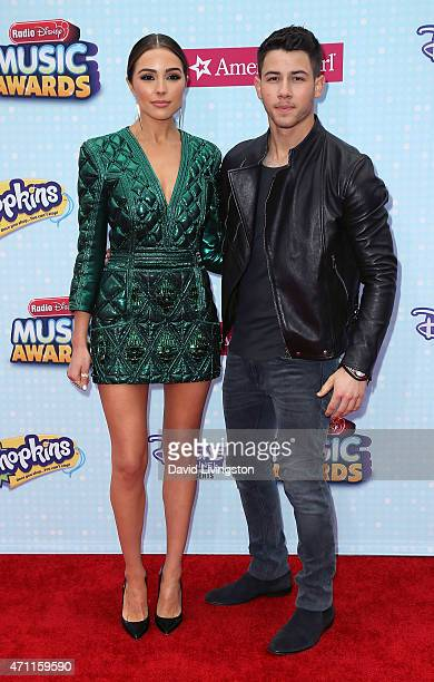 Miss Universe 2012 Olivia Culpo and singer Nick Jonas attend the 2015 Radio Disney Music Awards at Nokia Theatre LA Live on April 25 2015 in Los...