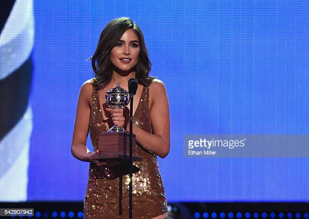 Miss Universe 2012 Olivia Culpo presents the Lady Byng Memorial Trophy during the 2016 NHL Awards at The Joint inside the Hard Rock Hotel Casino on...