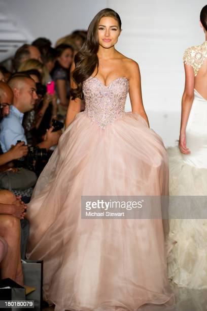 Miss Universe 2012 Olivia Culpo walks the runway during the Evening By Sherri Hill Spring 2014 show at Trump Tower on September 9 2013 in New York...