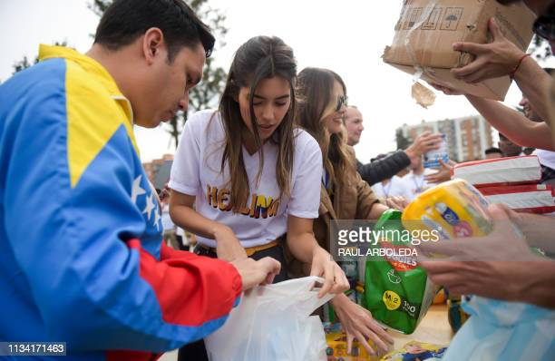 Miss Universe 2014 Colombian Paulina Vega and Miss Universe 2009 Venezuelan Stefania Fernandez take part in the Healing event to collect aid food and...