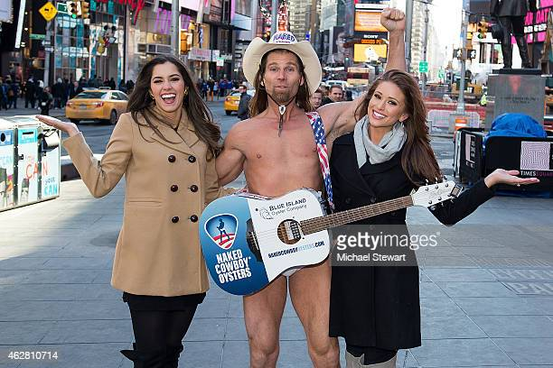 Miss Universe 2014 Paulina Vega Robert John Burck known as the Naked Cowboy and Miss USA 2014 Nia Sanchez seen in Times Square on February 5 2015 in...