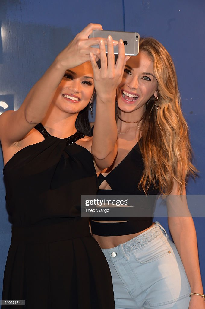 Miss Universe 2015 Pia Wurtzbach and Miss USA 2015 Olivia Jordan pose for a selfie at the Alice + Olivia By Stacey Bendet - Arrivals at The Gallery, Skylight at Clarkson Sq on February 16, 2016 in New York City.