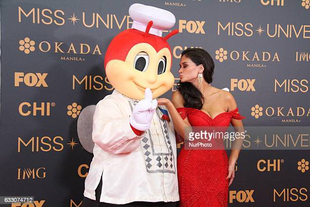 Miss Universe 2015 Pia Wurtzbach poses with a mascot during a red carpet event a day before the Miss Universe 2017 pageant in Pasay City south of...