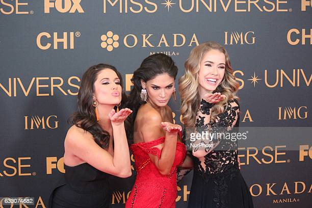 Miss Universe 2015 Pia Wurtzbach poses with Miss USA 2014 Nia Sanchez and Miss USA 2015 Olivia Jordan during a red carpet event a day before the Miss...