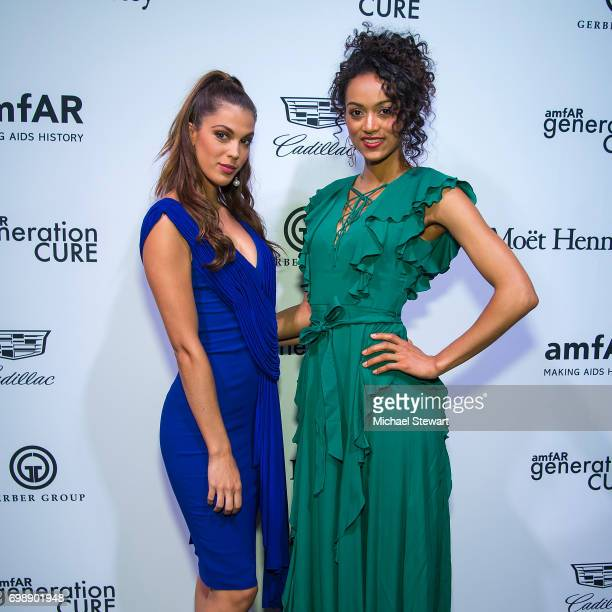 Miss Universe 2016 Iris Mittenaere and Miss USA 2017 Kara McCullough attend amfAR generationCURE Solstice 2017 at Mr Purple on June 20 2017 in New...
