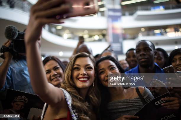 Miss Universe 2017 DemiLeigh NelPeters poses for a 'selfie' with fans as she arrives home to South Africa for the first time after being crowned at...