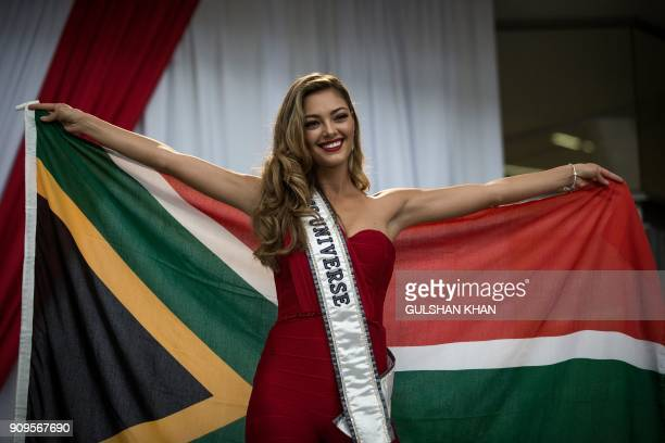 Miss Universe 2017 DemiLeigh NelPeters poses with a South African flag at OR Tambo International Airport in Johannesburg after arriving home to South...