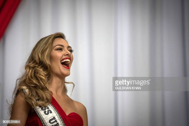Miss Universe 2017 DemiLeigh NelPeters smiles as she arrives home to South Africa for the first time after being crowned at OR Tambo International...