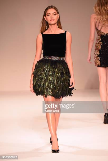 Miss Universe 2017 DemiLeigh NelPeters walks the runway during the NYFW Sherri Hill Runway Show on February 9 2018 in New York City