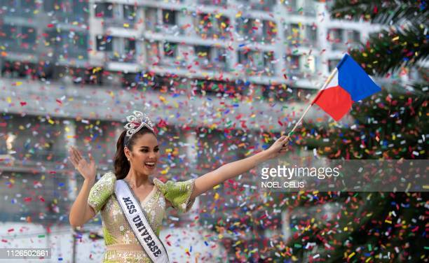 Miss Universe 2018 Catriona Gray of the Philippines waves to fans during a parade held in her honour in Manila on February 21 two months after she...