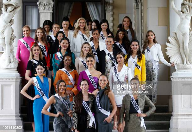 Miss Universe 2018 contestants pose for photos as the visit the Government House after their meeting with Thai Prime Minister in Bangkok on December...