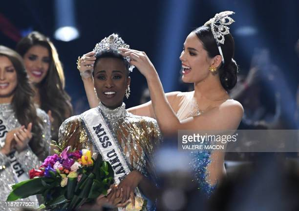 Miss Universe 2018 Philippines' Catriona Gray crowns the new Miss Universe 2019 South Africa's Zozibini Tunzi on stage during the 2019 Miss Universe...