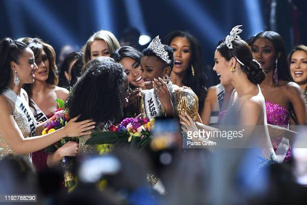 Miss Universe 2019 Zozibini Tunzi of South Africa is crowned onstage by Miss Universe 2018 Catriona Gray at the 2019 Miss Universe Pageant at Tyler...