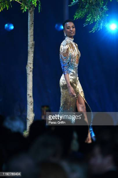 Miss Universe 2019 Zozibini Tunzi of South Africa just before she is crowned onstage appears in the evening wear competition at the 2019 Miss...