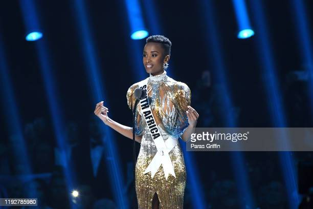 Miss Universe 2019 Zozibini Tunzi of South Africa just before she is crowned appears onstage at the 2019 Miss Universe Pageant at Tyler Perry Studios...