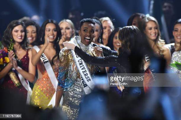 Miss Universe 2019 Zozibini Tunzi of South Africa receives her 2019 Miss Universe sash onstage at the 2019 Miss Universe Pageant at Tyler Perry...