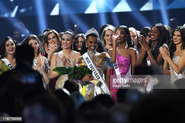 Miss Universe 2019 Zozibini Tunzi of South Africa waves onstage at the 2019 Miss Universe Pageant at Tyler Perry Studios on December 08 2019 in...