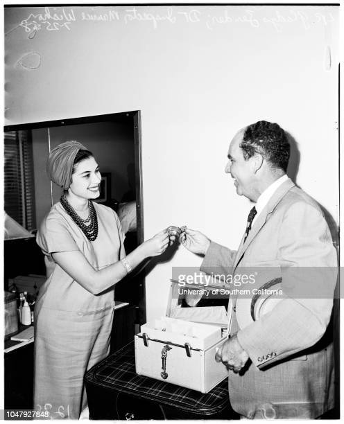 Miss Universe and jewels 25 July 1958 Gladys Zender Officer Maurice Wishon returns lost jewels to herCaption slip reads 'Photographer Emery Date...