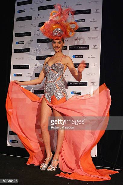 Miss Universe Australia Rachael Finch showcases the 'Sunset over the Opera House' outfit by Ruth Tarvydas at the official unveiling of the Australian...