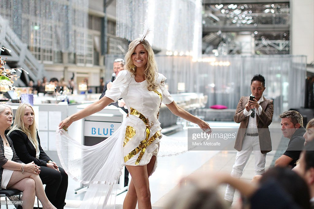 Miss Universe Australia, Renee Ayris, watched by designer Wayne Cooper walks the catwalk at the unveiling of the Australia National Costume on November 21, 2012 in Sydney, Australia.
