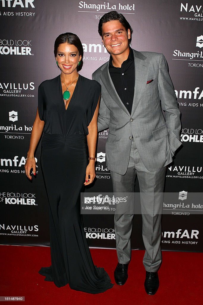 Miss Universe Canada 2012 Sahar Biniaz (L) and professional tennis player Milos Raonic attend amfAR Cinema Against AIDS TIFF 2012 during the 2012 Toronto International Film Festival at Shangri-La Hotel on September 7, 2012 in Toronto, Canada.
